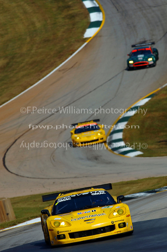 The #4 Corvette leads its sister car,#3 and the #58 Aston Martin through the Esses and into turn 5...Copyright©F.Peirce Williams 2005.ref.Digital Image Only