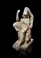 Roman statue of a seated woman . Marble. Perge. 2nd century AD. Inv no 17.7. . Antalya Archaeology Museum; Turkey. Against a black background.