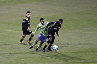 COLUMBUS, OH - DECEMBER 12: Joevin Jones #33 of the Seattle Sounders FC and Derrick Etienne Jr #22 of the Columbus Crew challenge for the ball during a game between Seattle Sounders FC and Columbus Crew at MAPFRE Stadium on December 12, 2020 in Columbus, Ohio.