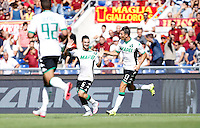 Calcio, Serie A: Roma vs Sassuolo. Roma, stadio Olimpico, 20 settembre 2015.<br /> Sassuolo's Matteo Politano, center, celebrates after scoring during the Italian Serie A football match between Roma and Sassuolo at Rome's Olympic stadium, 20 September 2015.<br /> UPDATE IMAGES PRESS/Isabella Bonotto