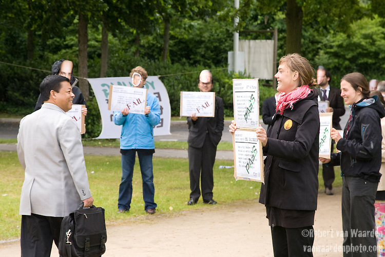 Young Friends of hte Earth Europe hand out report cards to the delgates as they enter the Maritim on the second last day of negotiatons. Several nations had failed their project and seeral had passed. United Nations Climate Talks in Bonn Germany (©Robert vanWaarden)