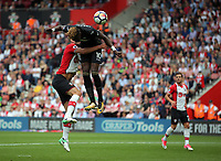 Tammy Abraham of Swansea City (R) heads the ball wide during the Premier League match between Southampton and Swansea City at the St Mary's Stadium, Southampton, England, UK. Saturday 12 August 2017