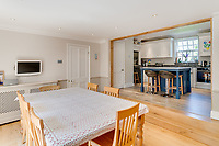 BNPS.co.uk (01202 558833)<br /> Pic: Mullucks/BNPS<br /> <br /> Pictured: Dining room and kitchen. <br /> <br /> Time for a change...<br /> <br /> A former granary with an impressive clock tower on top is on the market for £1.45m.<br /> <br /> The new owners of the aptly-named The Clockhouse will have a tall order adjusting this timepiece when the clocks go back at the end of October.<br /> <br /> The Grade II listed property has a 10ft central wooden clock tower which is believed to date back to the construction of the original granary building in the Georgian era.
