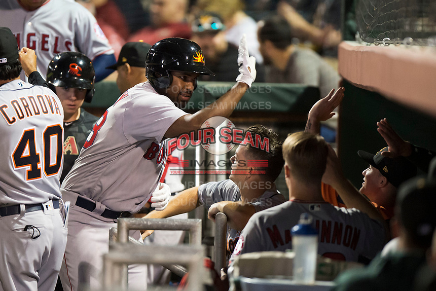 Mesa Solar Sox designated hitter Josh Ockimey (28), of the Boston Red Sox organization, celebrates an RBI sacrifice fly with his teammates in the dugout during an Arizona Fall League game against the Scottsdale Scorpions on October 9, 2018 at Scottsdale Stadium in Scottsdale, Arizona. The Solar Sox defeated the Scorpions 4-3. (Zachary Lucy/Four Seam Images)