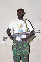 Sudanese PeopleÕs Liberation Army Soldiers (SPLA) - Many soldiers in the SPLA have been fighting since they were in their youth. Now, 20 years later, the Sudan war has ended in South Sudan. Their professions still lie in the military and their loyalty is dedicated to their newly liberated country, New Sudan. Nimule, Magwi County, Sudan, Africa December 2005 © Stephen Blake Farrington