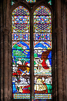 Medieval Gothic stained glass window showing  the Martyrdom of Saint Denis.The  Cathedral Basilica of Saint Denis ( Basilique Saint-Denis ) Paris, France. A UNESCO World Heritage Site.. The Gothic Cathedral Basilica of Saint Denis ( Basilique Saint-Denis ) Paris, France. A UNESCO World Heritage Site.. The Gothic Cathedral Basilica of Saint Denis ( Basilique Saint-Denis ) Paris, France. A UNESCO World Heritage Site.. The Gothic Cathedral Basilica of Saint Denis ( Basilique Saint-Denis ) Paris, France. A UNESCO World Heritage Site.