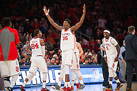 NEW YORK, NY - Sunday December 13, 2015: Yankuba Sima (#35) of St. John's celebrates having the lead against Syracuse as the two square off during the NCAA men's basketball regular season at Madison Square Garden in New York City.  St. John's would go on to win 84-72.