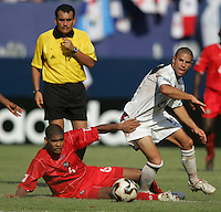 July 24, 2005: East Rutherford, NJ, USA:  USMNT midfielder Chris Armas (14) tries to step out of the tackle of Panama's Gabriel Gomez (6) during the CONCACAF Gold Cup Finals at Giants Stadium.