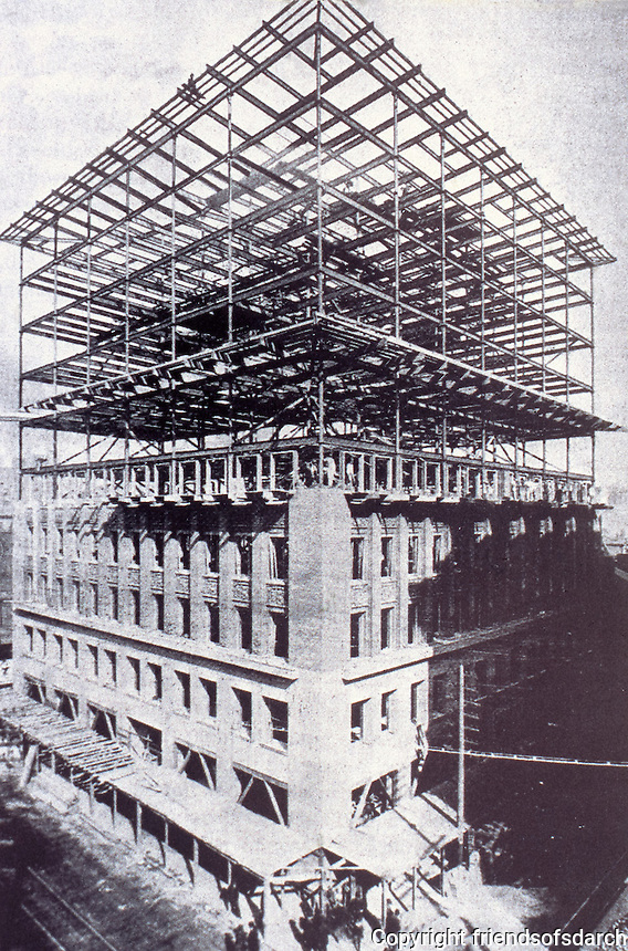 Louis Sullivan:  Wainwright Building under construction. Among first skyscaper buildings. St. Louis, MO. 10 story red brick office building. Chicago style architecture.(also Palazzo style), 1890-91. NHRP 1968.