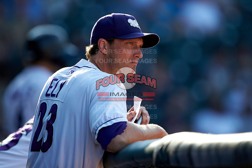 Winston-Salem Dash assistant coach John Ely (23) watches the action from the dugout during the game against the Carolina Mudcats at BB&T Ballpark on June 1, 2019 in Winston-Salem, North Carolina. The Mudcats defeated the Dash 6-3 in game one of a double header. (Brian Westerholt/Four Seam Images)