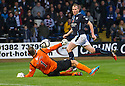 St Johnstone keeper Alan Mannus saves from Dundee's David Clarkson.