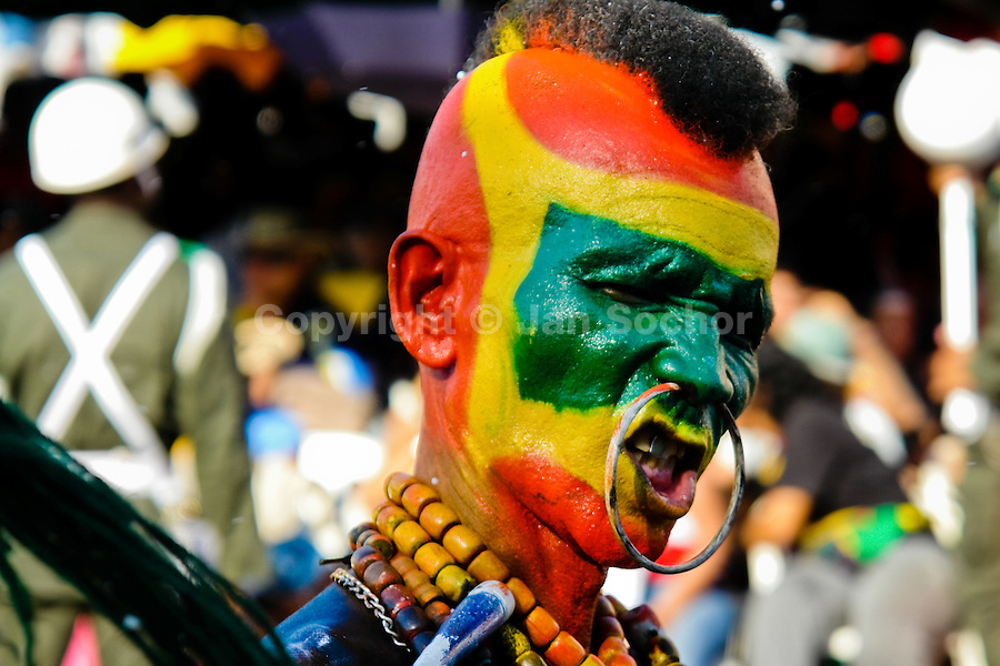 A Colombian man, wearing a Mohawk Indian make-up, dances during the Carnival in Barranquilla, Colombia, 27 February 2006. The Carnival of Barranquilla is a unique festivity which takes place every year during February or March on the Caribbean coast of Colombia. A colourful mixture of the ancient African tribal dances and the Spanish music influence - cumbia, porro, mapale, puya, congo among others - hit for five days nearly all central streets of Barranquilla. Those traditions kept for centuries by Black African slaves have had the great impact on Colombian culture and Colombian society. In November 2003 the Carnival of Barranquilla was proclaimed as the Masterpiece of the Oral and Intangible Heritage of Humanity by UNESCO.