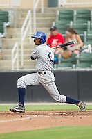Raimel Tapia (15) of the Asheville Tourists follows through on his swing against the Kannapolis Intimidators at CMC-NorthEast Stadium on July 13, 2014 in Kannapolis, North Carolina.  The Tourists defeated the Intimidators 8-2.  (Brian Westerholt/Four Seam Images)