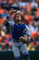 SAN FRANCISCO, CA:  Mike Piazza of the Los Angeles Dodgers chases a pop up during a game against the San Francisco Giants at Candlestick Park in San Francisco, California on April 17, 1996. (Photo by Brad Mangin)