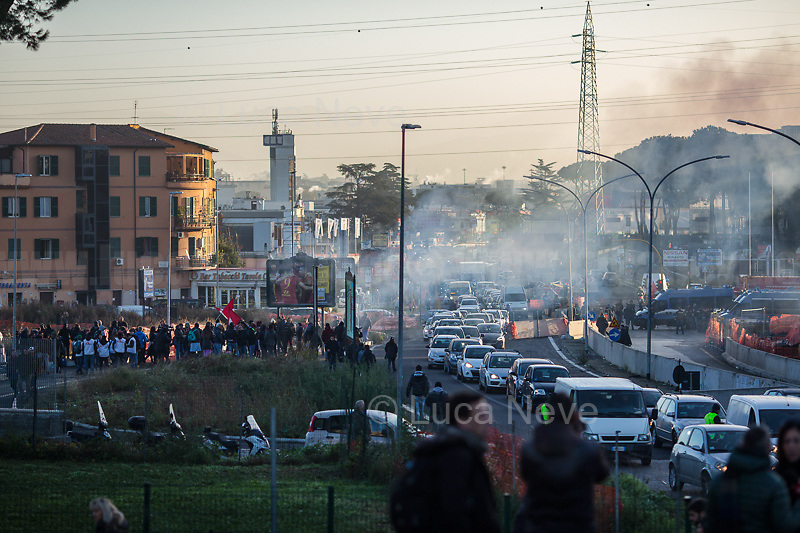 Rome, 10/12/2018. Today, the derelict former factory of the Penicillin in the east area of Rome was evicted and evacuated by a conspicuous number police officers in full riot gears (Polizia and Carabinieri) supported by fire fighters and the Rome municipal police. The abandoned and run-down factory once was home to an estimated 500 people, including migrants of different nationalities but also Italian families who lived in extreme poverty and poor hygienic and health conditions (presence of asbestos and others). The eviction, which saw the last 35 inhabitants took away on a bus by the police, was attended by the far-right leader of League (Lega), anti-immigration Minister of the Interiors and Deputy Prime Minister, Matteo Salvini. A group of protesters and activists held a rally against the eviction without a plan to rehouse the people of the Ex Penicillin but it was kept away from the main gate of the raw-concrete skeleton building.<br />