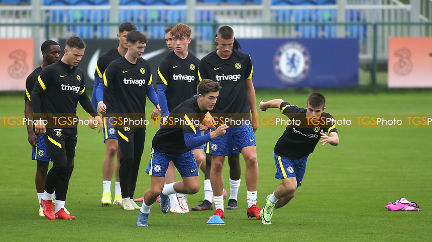 Leo Castledine and Ronnie Stutter of Chelsea U19's sprint upfield in the pre-match warm up during Chelsea Under-19 vs FC Zenit Under-19, UEFA Youth League Football at Cobham Training Ground on 14th September 2021