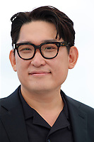 """CANNES, FRANCE - JULY 16:  Director Han Jae-rim at the """"Bi-Sang-Seon-Eon/Emergency Declaration"""" photocall during the 74th annual Cannes Film Festival on July 16, 2021 in Cannes, France. <br /> CAP/GOL<br /> ©GOL/Capital Pictures"""