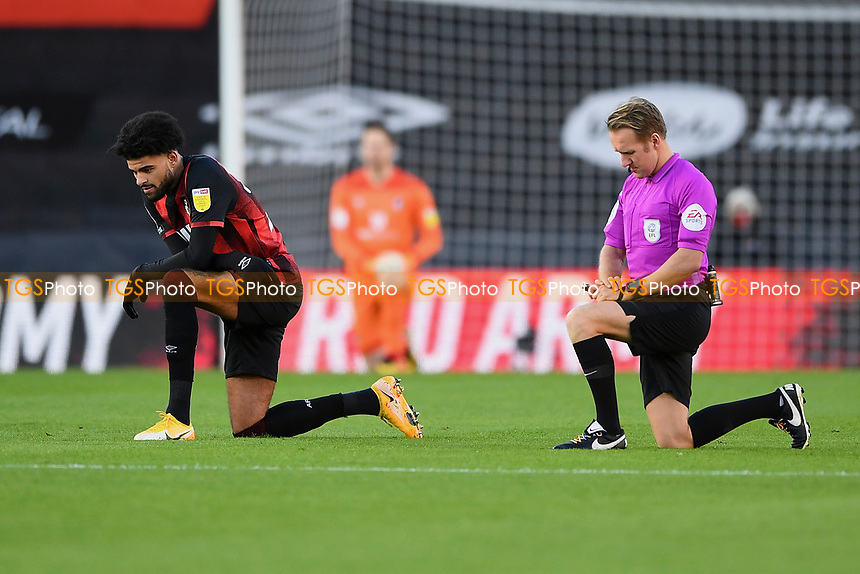 Referee Oliver Langford joins Philip Billing of AFC Bournemouth in taking the knee before kick off during AFC Bournemouth vs Huddersfield Town, Sky Bet EFL Championship Football at the Vitality Stadium on 12th December 2020