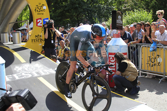 Christopher Froome (GBR) Sky Procycling powers down the start ramp during the Prologue of the 99th edition of the Tour de France 2012, a 6.4km individual time trial starting in Parc d'Avroy, Liege, Belgium. 30th June 2012.<br /> (Photo by Eoin Clarke/NEWSFILE)