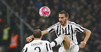 Calcio, Serie A: Juventus vs Inter. Torino, Juventus Stadium, 28 February 2016.<br /> Juventus' Leonardo Bonucci, right, kicks the ball past his teammate Giorgio Chiellini during the Italian Serie A football match between Juventus and Inter at Turin's Juventus Stadium, 28 February 2016.<br /> UPDATE IMAGES PRESS/Isabella Bonotto