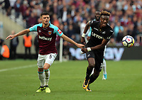 (L-R) Aaron Cresswell of West Ham and Tammy Abraham of Swansea City watch the ball move forward during the Premier League match between West Ham United v Swansea City at the London Stadium, London, England, UK. Saturday 30 September 2017