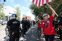 PORTLAND, OR - AUGUST 04: Far-Right protesters rally for gun rights' laws and free speech on August 4, 2018 in Portland, Oregon. (Photo by Karen Ducey/Getty Images)