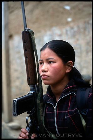 """An 18 year old Maoist rebel soldier who goes by her communist party name """"Asina"""" poses for a portrait in the village of Gairigaon, Nepal on Thursday, 17 February 2005. Asina says she joined the P.L.A. three years ago.<br />"""