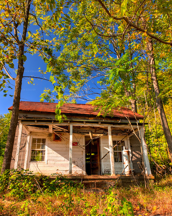 As we left Stone Mountain Vineyards, we passed this old building in the woods.  From the looks of the old ennunciator and display panel (by the window, left of the door), this may once have been a train or bus station of some sort.  (HDR Image)