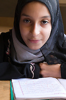 Surman, Libya.  Girl Memorizing the Koran in the Madrasa of Sidi Rashid al-Galili.  Young girls wear the traditional Libyan head scarf.