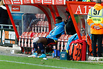 Wrexham 2 Ebbsfleet United 0, 18/11/2017. The Racecourse Ground, National League. After suffering a knee injury and being substituted, Yado Mambo of Ebbsfleet United sits on the bench with an ice pack at half time. Photo by Paul Thompson.