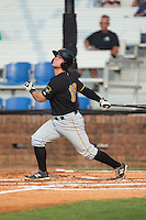 Erik Lunde (18) of the Bristol Pirates follows through on his swing against the Johnson City Cardinals at Howard Johnson Field at Cardinal Park on July 6, 2015 in Johnson City, Tennessee.  The Pirates defeated the Cardinals 2-0 in game one of a double-header. (Brian Westerholt/Four Seam Images)