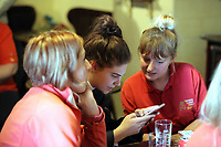 Pictured: Regulars check race results on a mobile phone before the race at Cresselly Arms pub in Cresswell Quay, Pembrokeshire, Wales, UK. Thursday 16 March 2017<br /> Re: A racehorse owned by a syndicate from Pembrokeshire which was a favourite to win at this year's Cheltenham Festival, has lost.<br /> Tobefair, a seven-year-old gelding, has won his last seven races.<br /> He was gifted as a colt to Michael Cole three years ago, in return for looking after two fillies on his farm.<br /> Unable to afford the training costs on his own, he decided to offer 50% of the ownership to people he knew through his local pub, the Cresselly Arms at Cresswell Quay Quay.<br /> The syndicate grew to 17 members but none except Mr Cole had owned a racehorse before.<br /> They said they were amazed when Tobefair started winning races and never dreamed he would make it to Cheltenham.