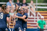 NEWTON, MA - MAY 22: Jackie Wolak #23 of Notre Dame celebrates her goal with teammate during NCAA Division I Women's Lacrosse Tournament quarterfinal round game between Notre Dame and Boston College at Newton Campus Lacrosse Field on May 22, 2021 in Newton, Massachusetts.