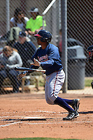 Atlanta Braves catcher Carlos Martinez (8) during a minor league spring training game against the Houston Astros on March 29, 2015 at the Osceola County Stadium Complex in Kissimmee, Florida.  (Mike Janes/Four Seam Images)