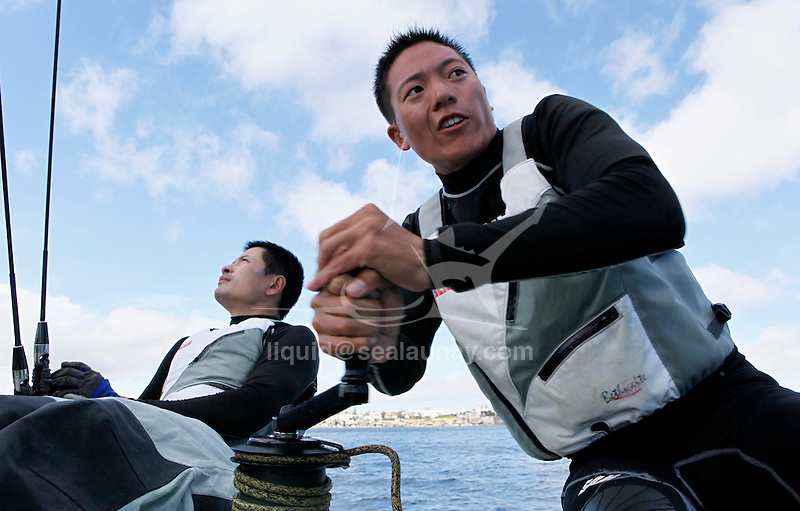 Onboard the AC 45 China Team 1 during a training session in Cascais Portugal before the start of the America's Cup World Series..Liu Cheng Qi Larry.Wu Liang William