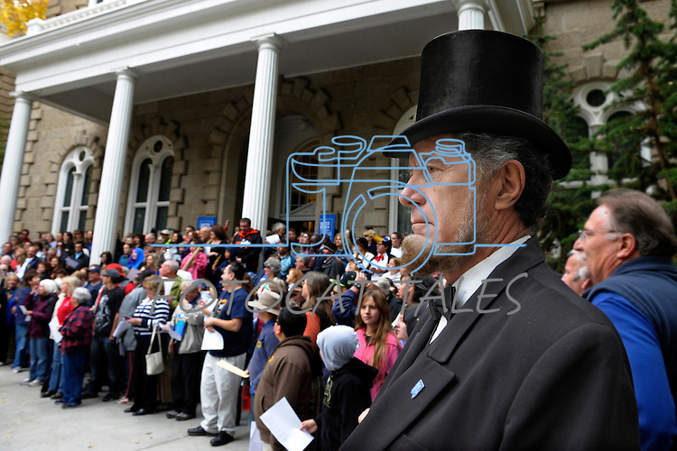 """Wally Earhart as Abe Lincoln, right, and numerous others gather on the Capitol steps Thursday, Oct. 30, 2014 for #NevadaSings!, a statewide sing-a-long of """"Home Means Nevada."""" Approximately 370 people took part  in the Carson City portion of the event, which seeks to establish a new record for the most people in an American state to sing their state song at the same time."""