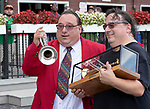 """Sam """"The Bugler"""" Grossman  is honored  by NYRA at Saratoga Race Course, Sep. 3, 2018.    On closing day of the Saratoga meet  the retirement of Grossman  is celebrated after 25 years of service.  His twin brother joined him in the winner's circle.  (Bruce Dudek/Eclipse Sportswire)"""