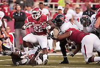 NWA Democrat-Gazette/BEN GOFF @NWABENGOFF<br /> Rawleigh Williams III, Arkansas running back, breaks the tackle of Texas Tech defensive lineman Gary Moore (5) as  Arkansas left guard Sebastian Tretola blocks Texas Tech defensive end Pete Robertson in the second quarter on Saturday Sept. 19, 2015 during the game in Razorback Stadium in Fayetteville.