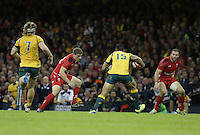 Pictured: Israel Folau of Australia (15) is closely watched by Rhys Priestland (2nd L) and Jamie Roberts (R) of Wales Saturday 08 November 2014<br />