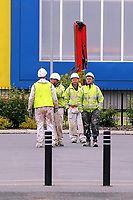 Pictured: Workers at Kennedy Gardens flats in Billingham. Tuesday 27 June 2017<br /> Re: Cladding is being removed by workers from the fascia of high-rise flats at Kennedy Gardens in Billingham, County Durham, England, UK