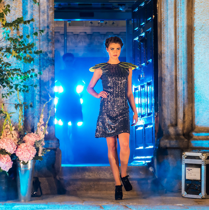 A model emerges from the Powerscourt Centre, Dublin, Ireland, during an evening outdoor fashion show.