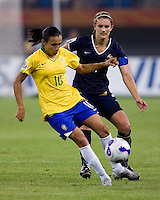 Brazil forward (10) Marta takes a touch on the ball in front of Australia defender (4) Dianne Alagich during the quarterfinals of the FIFA Women's World Cup at Tianjin Olympic Center Stadium in Tianjin, China.  Brazil defeated Australia, 3-2.