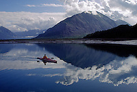 A KAYAKER surrounded by the majestic serenity of ADAMS INLET - GLACIER BAY NATIONAL PARK, ALASKA (MR)