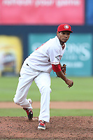 Alberto Tirado #38 of the Vancouver Canadians pitches against the Hillsboro Hops at Nat Bailey Stadium on July 24, 2014 in Vancouver, British Columbia. Hillsboro defeated Vancouver, 7-3. (Larry Goren/Four Seam Images)