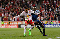 Harrison, NJ - Wednesday Feb. 22, 2017: Salvatore Zizzo, Alphonso Davies during a Scotiabank CONCACAF Champions League quarterfinal match between the New York Red Bulls and the Vancouver Whitecaps FC at Red Bull Arena.
