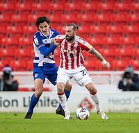 6th February 2021; Bet365 Stadium, Stoke, Staffordshire, England; English Football League Championship Football, Stoke City versus Reading; Steven Fletcher of Stoke City under pressure from Tom McIntyre of Reading