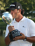 Scott Piercy celebrates after winning the Reno-Tahoe Open at the Montreux Golf & Country Club in Reno, Nev., on Sunday, Aug. 7, 2011. .Photo by Cathleen Allison