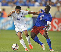 Andy Najar (14) of Honduras goes against Ives Hadley (15) of Haiti.  Honduras defeated Haiti 2-0 in the first round of the CONCACAF Gold Cup, at Red Bull Arena, Monday July 8 , 2013.