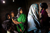 Guddi Devi (centre) seen with her malnourished 18 month daughter, Khushi and the extended family members in their house in Bishambharpur village in Muzaffarpur in Bihar, India. Photograph: Sanjit Das/Panos for Legatum Foundation