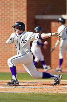 Ryan Retz #34 of the High Point Panthers follows through on his swing against the Dayton Flyers at Willard Stadium on February 26, 2012 in High Point, North Carolina.    (Brian Westerholt / Four Seam Images)